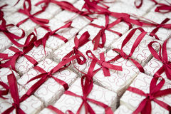 Wedding favours. Maroon ribbonned wedding favour boxes Royalty Free Stock Images