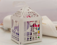 Wedding favours in a paper cage Stock Images