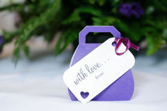 Wedding favours purple. Closeup of violet wedding favours gift at wedding reception Royalty Free Stock Image