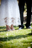 Wedding Feet. A bride and groom's feet on their wedding day Stock Image