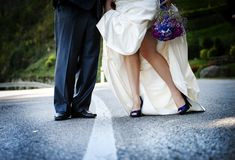Wedding feet. Bride and groom are walking outside together Royalty Free Stock Photo