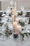 Wedding or festive table setting. Plates, wine glasses, candles and cutlery. Beautiful arrangement Stock Photo