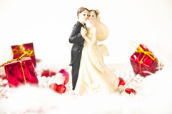 Wedding figurines. With red gifts Stock Photo