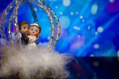 Wedding figurines on bright background stock photos