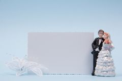 Wedding figurines and greeting card Stock Photos