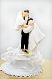 Wedding figurines and wedding rings. On white background Royalty Free Stock Image