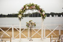 Wedding floral arch on the beach Royalty Free Stock Images