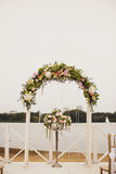 Wedding floral arch on the beach Stock Photos