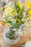 Wedding floral arrangement on the table, meadow flowers for bride.  Stock Images