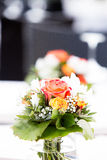 Wedding floral arrangement. Floral arrangement on tabletop for wedding reception royalty free stock photos