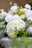 Wedding floral arrangement. With white hydrangea hortensia, carnation, rose, eustoma, chamelaucium wax flower and asparagus leaves stock photos