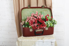 Wedding floral decor composition. Unusual wedding floral decor composition - flowers in vintage brown suitcase. Old suitcase with flowers. Decoration with royalty free stock photography