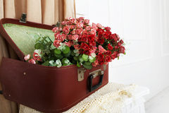 Wedding floral decor composition. Unusual wedding floral decor composition - flowers in vintage brown suitcase. Old suitcase with flowers. Decoration with royalty free stock photo