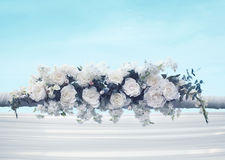 Wedding floral decorations gentle white flowers over blue sky background Stock Images