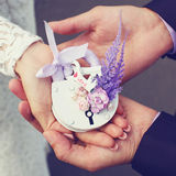 Wedding floral lock in hands bride and groom Stock Photography