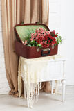 Wedding floral rose decor composition. Shabby chic wedding. Wedding floral decor composition, flowers in vintage brown suitcase at bedside. Old suitcase with stock photography