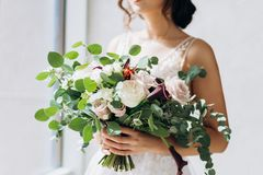 Wedding floristry in the hands of the bride. stock photography