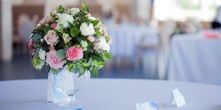 Wedding floristry. Beautiful lush bouquet on the table in restaurant Stock Photography