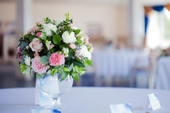 Wedding floristry. Beautiful lush bouquet on the table in restaurant Royalty Free Stock Images