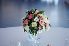 Wedding floristry. Beautiful lush bouquet on the table in restaurant Stock Photo