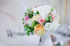 Wedding floristry. Beautiful lush bouquet on the table in restaurant Royalty Free Stock Image
