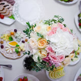 Wedding floristry. Beautiful lush bouquet on the table in restaurant Stock Images