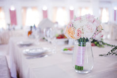 Wedding floristry. Beautiful lush bouquet on the table in restaurant Stock Photos