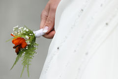 Wedding flower. For bridegroom in hand of spouse Royalty Free Stock Photos