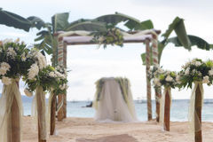 Wedding flower arch, post and decoration on beach Royalty Free Stock Photos