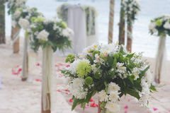 Wedding flower arch, post and decoration on beach stock photos