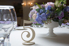 Wedding flower arrangement. With blue violet pink flowers Stock Photos