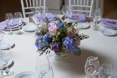 Wedding flower arrangement. With blue violet pink flowers Stock Images