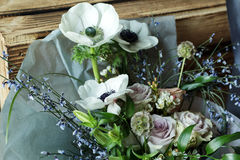 Wedding Flower arrangement. Flower arrangement with branches of a pistachio branches of Ruscus, carnations, roses, branch of Brunei, berries of Hypericum Stock Images