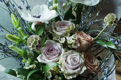 Wedding Flower arrangement. Flower arrangement with branches of a pistachio branches of Ruscus, carnations, roses, branch of Brunei, berries of Hypericum Stock Image