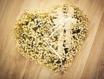 Wedding Flower Arrangement. Heart-shaped wedding flower arrangement with wedding rings on it Stock Images