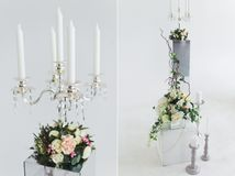 Wedding Flower Arrangements set. Decorations of candles and flowers Royalty Free Stock Image