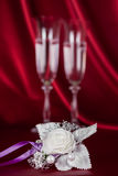 Wedding flower on the background of two wine glasses Royalty Free Stock Photos