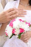 Wedding flower banch with newlyweds hands Royalty Free Stock Images