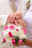 Wedding flower banch with newlyweds hands Stock Image