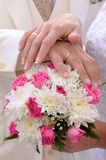 Wedding flower banch with newlyweds hands Stock Photo