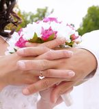 Wedding flower banch with newlyweds hands Royalty Free Stock Photography
