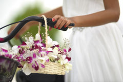 Wedding Flower basket with Orchids. With intricate designs produced from memory and mainly featured on wood carved objects such as vases and jewellery boxes Stock Image