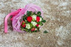 Wedding flower bouquet on carpet Royalty Free Stock Photo