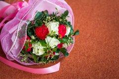 Wedding flower bouquet on cushion Stock Photography