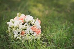 Wedding flower bouquet on green grass Royalty Free Stock Images