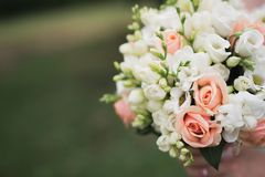 Wedding flower bouquet on green grass Royalty Free Stock Image