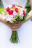 Wedding flower bouquet. In hands of bride in white dress Royalty Free Stock Photo
