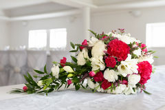 Wedding flower bouquet. Wedding bouquet or red and white flowers on a table in restaurant Royalty Free Stock Images