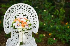 Wedding flower bouquet on a white garden chair Stock Image