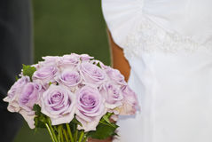 Wedding flower bouquetand dress Stock Image